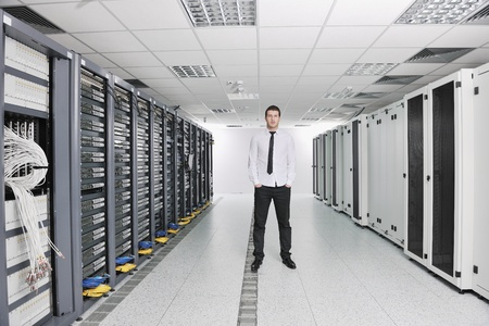 young handsome business man  engeneer in datacenter server room  Stock Photo - 8437190