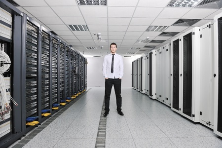 young handsome business man  engeneer in datacenter server room Stock Photo - 8437197