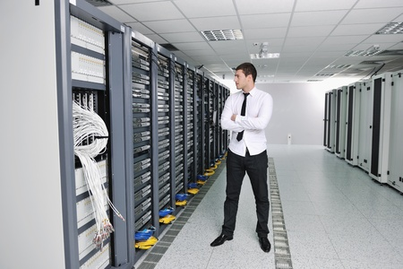 young handsome business man  engeneer in datacenter server room  Stock Photo - 8437188