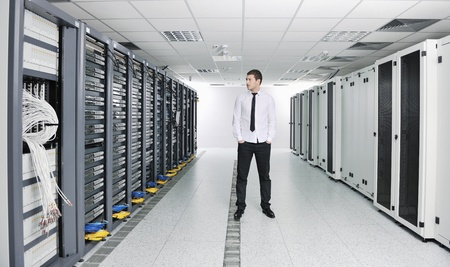 young handsome business man  engeneer in datacenter server room Stock Photo - 8437185