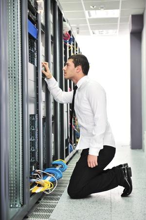 young handsome business man  engeneer in datacenter server room Stock Photo - 8437186