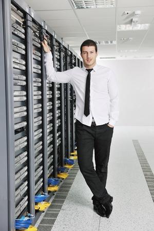 young handsome business man  engeneer in datacenter server room Stock Photo - 8437187