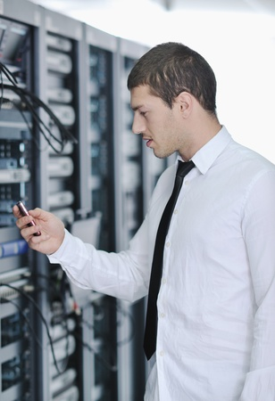 young handsome business man  engeneer in datacenter server room Stock Photo - 8437146