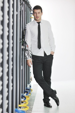 young handsome business man  engeneer in datacenter server room Stock Photo - 8437089