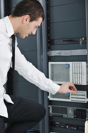 young handsome business man  engeneer in datacenter server room Stock Photo - 8437143