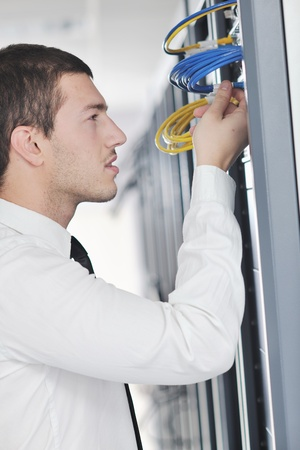 young handsome business man  engeneer in datacenter server room Stock Photo - 8437140