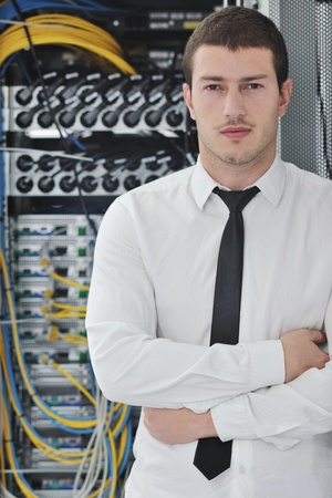 young handsome business man  engeneer in datacenter server room Stock Photo - 8437176