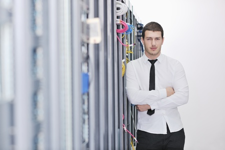 young handsome business man  engeneer in datacenter server room  Stock Photo - 8437145