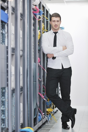 young handsome business man  engeneer in datacenter server room Stock Photo - 8437180