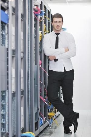 young handsome business man  engeneer in datacenter server room Stock Photo - 8437180