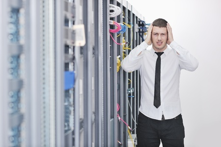 young handsome business man  engeneer in datacenter server room Stock Photo - 8437141