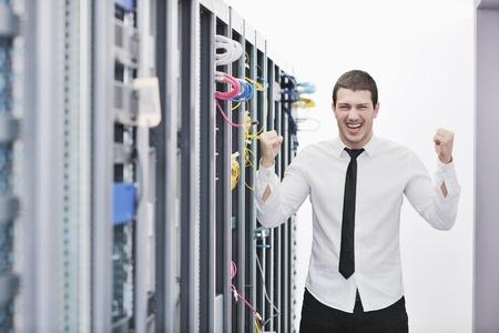 young handsome business man  engeneer in datacenter server room Stock Photo - 8437155