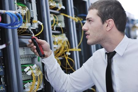 engeneer: young handsome business man  engeneer in datacenter server room