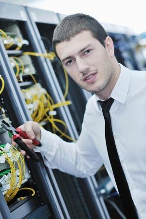 young handsome business man  engeneer in datacenter server room Stock Photo - 8437171