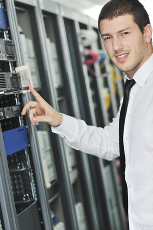 young handsome business man  engeneer in datacenter server room  Stock Photo - 8437175
