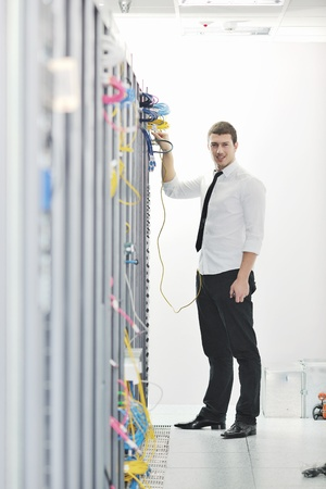 young handsome business man  engeneer in datacenter server room Stock Photo - 8437087