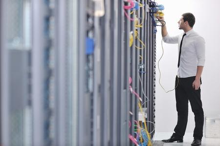 young handsome business man  engeneer in datacenter server room Stock Photo - 8437138
