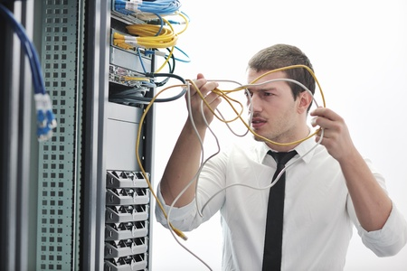 young handsome business man  engeneer in datacenter server room Stock Photo - 8437144