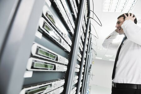 fail: business man in network server room have problems and looking for  disaster solution