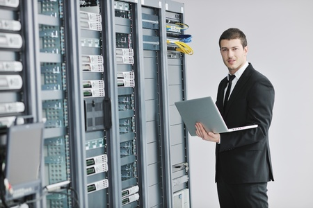 young engeneer business man with thin modern aluminium laptop in network server room Stock Photo - 8445734