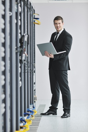 young engeneer business man with thin modern aluminium laptop in network server room Stock Photo - 8445722