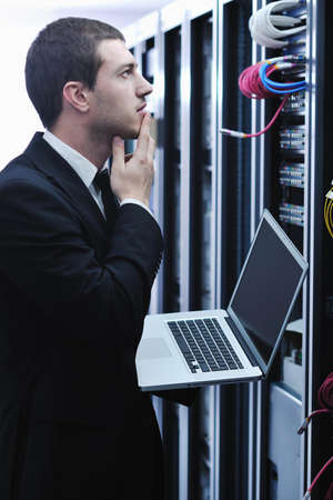 young engeneer business man with thin modern aluminium laptop in network server room Stock Photo - 8445706