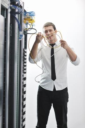 young handsome business man  engeneer in datacenter server room Stock Photo - 8445703