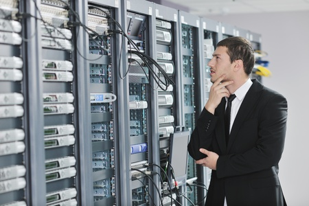 young handsome business man  engeneer in datacenter server room  Stock Photo - 8445748