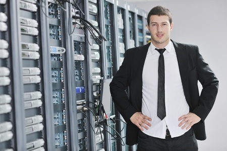 young handsome business man  engeneer in datacenter server room Stock Photo - 8445746