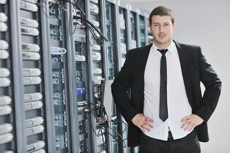 young handsome business man  engeneer in datacenter server room Stock Photo - 8445746