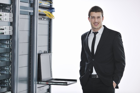 young handsome business man  engeneer in datacenter server room Stock Photo - 8445702