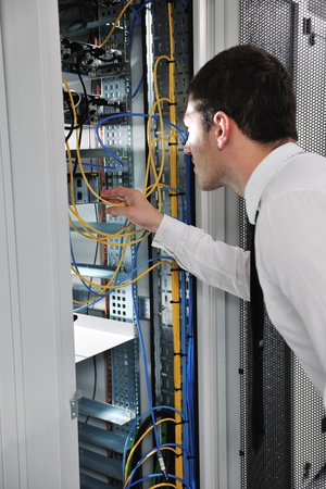 young handsome business man  engeneer in datacenter server room Stock Photo - 8445752