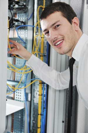 young handsome business man  engeneer in datacenter server room  Stock Photo - 8445745
