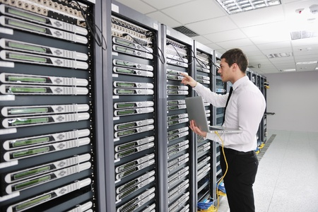 web server: young handsome business man  engeneer in datacenter server room