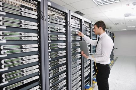 isp: young handsome business man  engeneer in datacenter server room