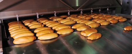 cake factory: bread bakery food factory production with fresh products Stock Photo