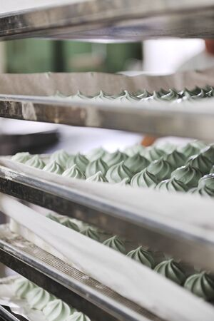 cake factory: many sweet cake food factory massive production Stock Photo