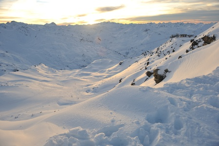 val: mountain snow fresh sunset at ski resort in france val thorens