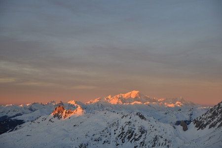 mountain snow fresh sunset at ski resort in france val thorens Stock Photo - 8757597