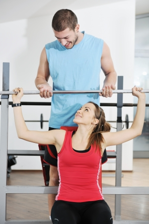 happy young couple fitness workout and fun at sport gym club  Stock Photo - 8750914