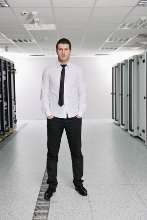 young handsome business man it  engeneer in datacenter server room Stock Photo - 8757510