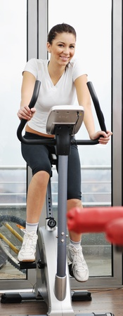 trample: young woman exercise fitness and workout while run on track in sport club Stock Photo