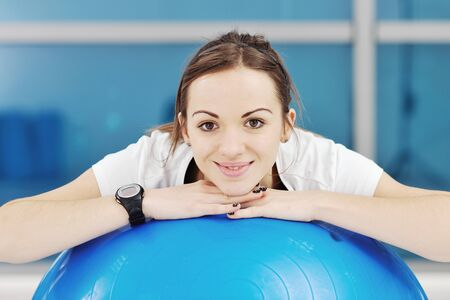 happy diet concept with young woman on pink scale at sport fitnes gym club Stock Photo - 8767784