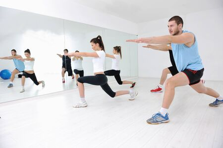 aerobic training: happy young people group in excercise and relax in  fitness club Stock Photo