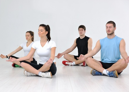 cardio: happy young people group in excercise and relax in  fitness club Stock Photo