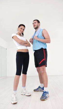 weight loss man: happy young couple fitness workout and fun at sport gym club Stock Photo