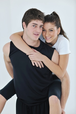 happy young couple fitness workout and fun at sport gym club Stock Photo - 8772655