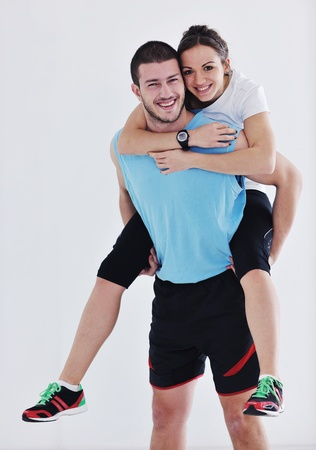 fitness instructor: happy young couple fitness workout and fun at sport gym club Stock Photo
