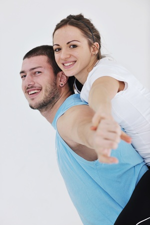 happy young couple fitness workout and fun at sport gym club photo