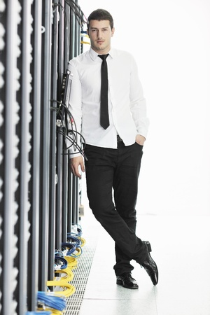 young handsome business man it  engeneer in datacenter server room Stock Photo - 8759723